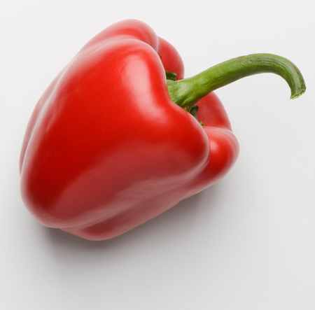 Red bell pepper on white