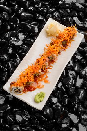 Sushi maki on white platter Reklamní fotografie - 117222255