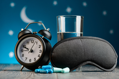 Alarm clock, pills, mask