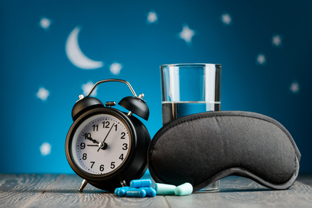 Clock, pills, earplugs, mask Stok Fotoğraf