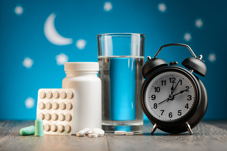 Earplugs, pills and clock