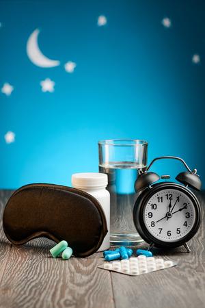 Eye mask, earplugs and sleeping pills