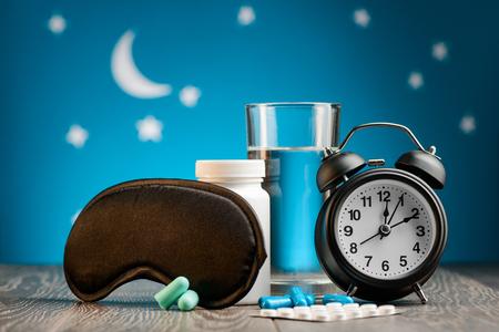 Mask, pills and alarm clock