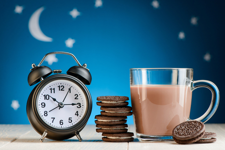 Clock, chocolate cookies and cocoa Stock fotó