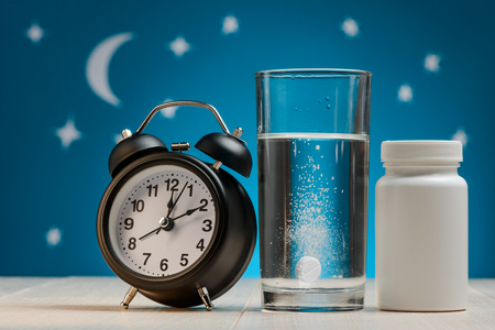 Alarm clock, water with tablet