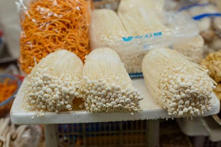 Enoki or Golden needle mushrooms Фото со стока