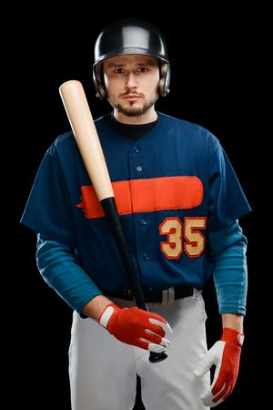 Baseball player posing with bat
