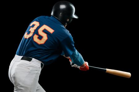 Batter hitting a ball
