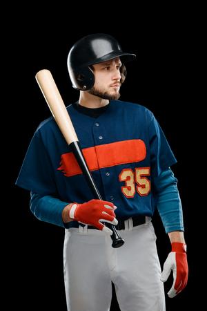 Handsome baseball batter on black