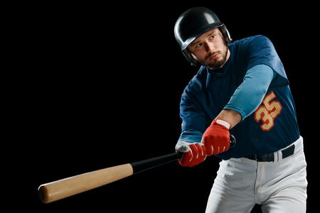 Baseball player swinging a bat 스톡 콘텐츠