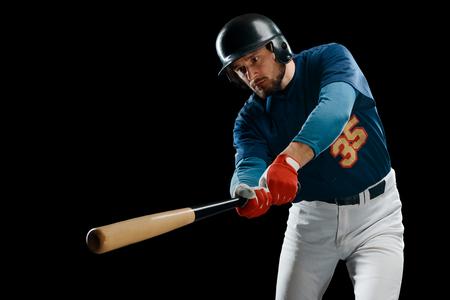 Man swings a wooden bat
