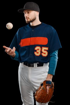 Baseball pitcher throwing ball up Stock Photo