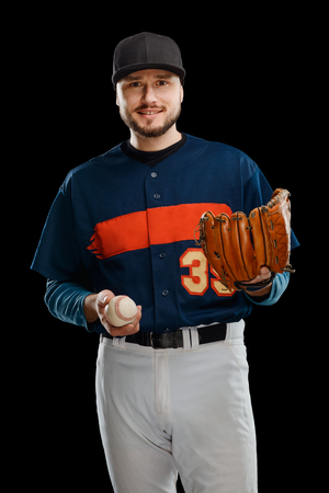 Amateur baseball player on black Stock Photo