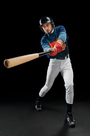 Baseball player hitting a ball