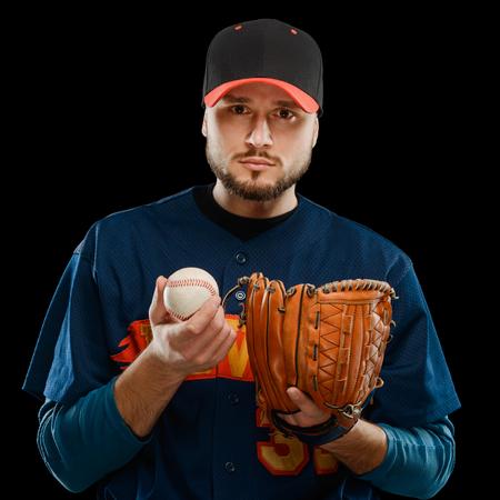 Bearded baseball player on black