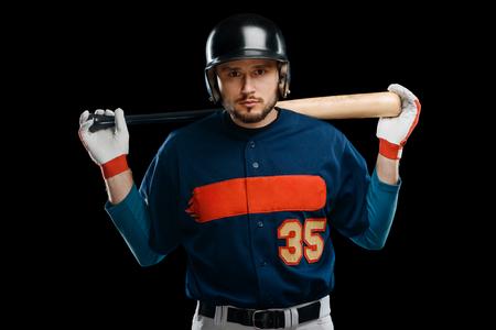 Baseball player on black background
