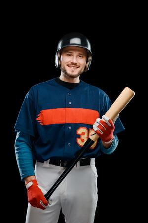 Smiling baseball player holding bat 스톡 콘텐츠