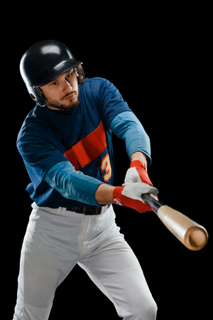 Baseball player practicing a hit