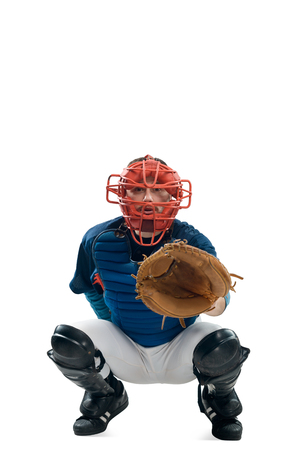 Catcher squatting behind home plate