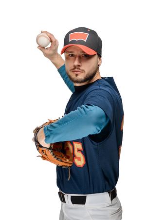 Baseball player pitching a ball Stock Photo
