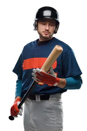 Baseball player looking at bat