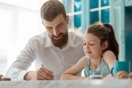 Dad and daughter doing homework Stock Photo