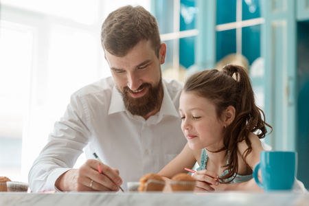 Happy dad drawing with daughter