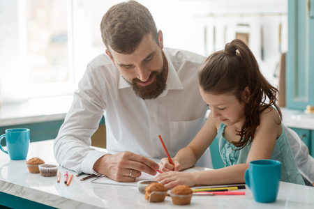 Dad looks his daughter drawing