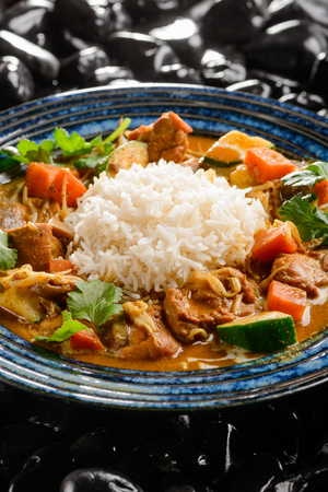 Chicken curry with rice Imagens