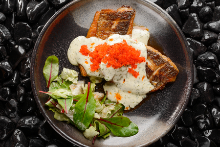 Grilled seabass with caviar Stock Photo