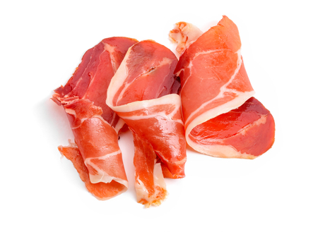 Jamon slices on white background Imagens