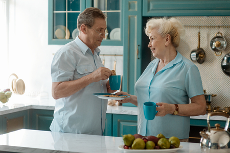 Retired couple having a breakfast Stock Photo