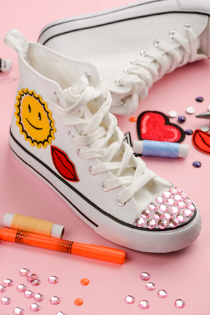 White sneakers with patches