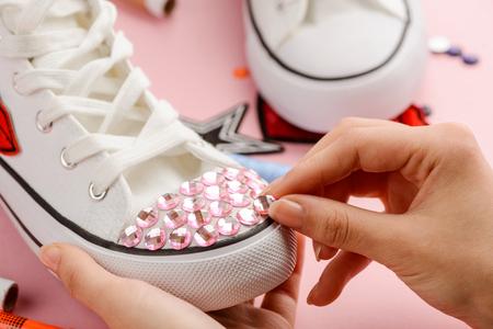 Girl putting pink rhinestones 写真素材