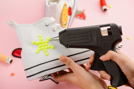 Putting yellow decorations on sneakers 写真素材