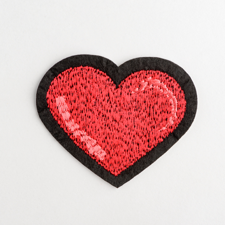 Red heart embroidery patch Stock Photo