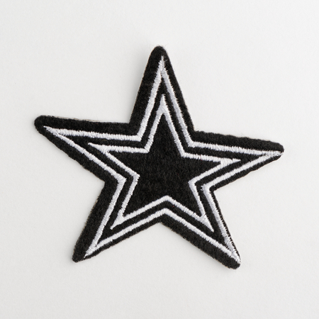 Black star fabric patch Stock Photo