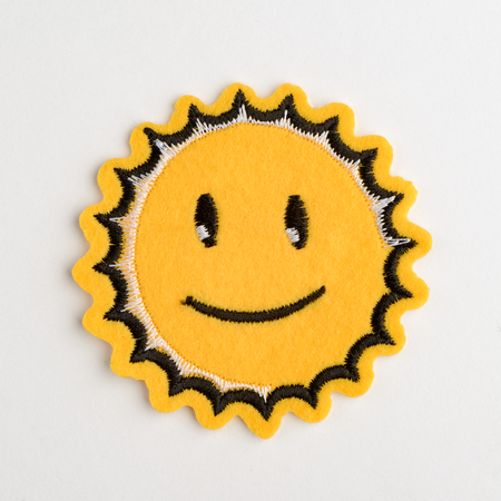 Smiling sun embroidered felt patch