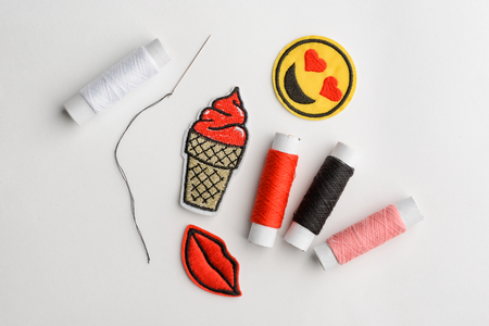Embroidered patches, needle and thread Stockfoto