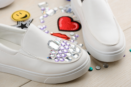 White shoes decorated with rhinestones Stock Photo