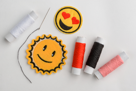 Emoji embroidered patches and thread