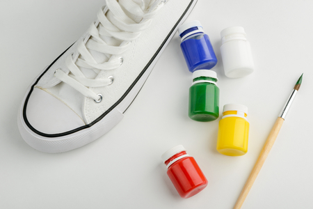 Sneaker, paint and brush