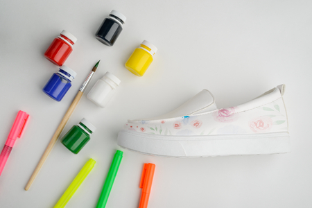 Leather slip-on shoes with flowers
