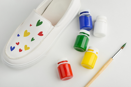 White shoe with colorful painted hearts