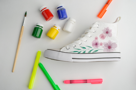 Canvas sneaker with painted flowers
