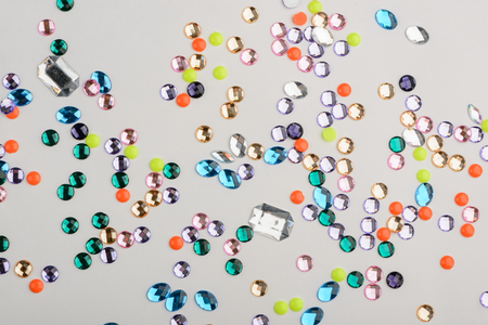 Scattered heap of colorful rhinestones