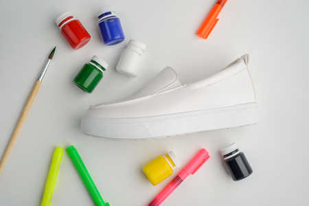 Paint, markers, brush and shoe Stockfoto