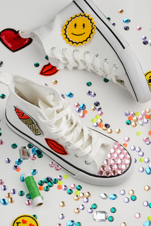 White sneakers decorated with rhinestones