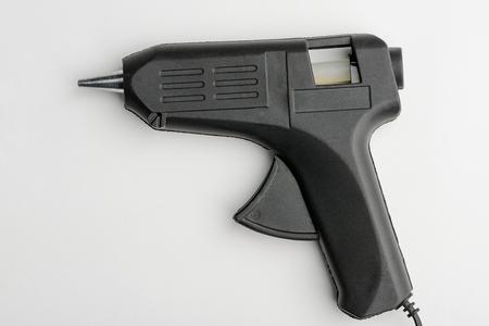 Hot glue gun on white