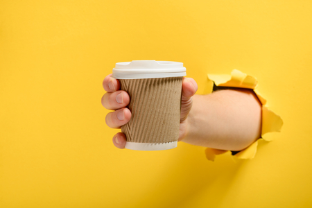 Hand taking a cup